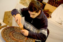 Woodcarving master in Abulkasym Madrasah